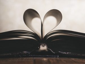 Shadowy heart image formed from folded book pages